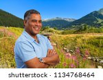 handsome middle age hispanic... | Shutterstock . vector #1134768464