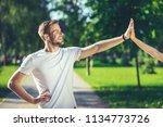 profile of happy male standing... | Shutterstock . vector #1134773726