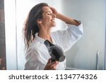 side view beaming girl... | Shutterstock . vector #1134774326