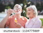 mature man is blowing bubbles... | Shutterstock . vector #1134775889