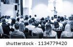 speaker giving a talk in... | Shutterstock . vector #1134779420