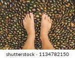 woman walking on a textured... | Shutterstock . vector #1134782150