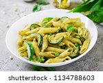 penne pasta with  pesto sauce ... | Shutterstock . vector #1134788603