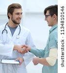 doctor congratulating the... | Shutterstock . vector #1134810146