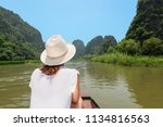 young woman traveling by boat... | Shutterstock . vector #1134816563