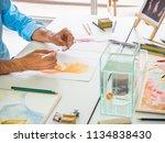 watercolor class.closeup hand... | Shutterstock . vector #1134838430