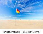 surf life saving flag on the... | Shutterstock . vector #1134840296