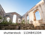 exploring abandoned church at a ...   Shutterstock . vector #1134841334