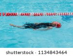 a girl learn how to swim in... | Shutterstock . vector #1134843464