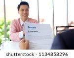asian man in job interview at... | Shutterstock . vector #1134858296