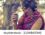 woman drinking a mate | Shutterstock . vector #1134865340