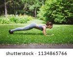 cute young woman doing yoga... | Shutterstock . vector #1134865766