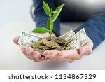 business man hand make palm up... | Shutterstock . vector #1134867329