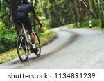 cyclist he was cycling uphill... | Shutterstock . vector #1134891239