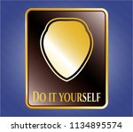 gold shiny emblem with shield... | Shutterstock .eps vector #1134895574