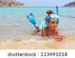 Girl in the shallow sea - stock photo