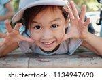 cute multicultural asain girl... | Shutterstock . vector #1134947690