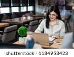 close up the hand of an asian... | Shutterstock . vector #1134953423