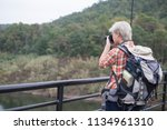 man travelling with  camera and ... | Shutterstock . vector #1134961310
