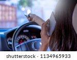 female in car using remote... | Shutterstock . vector #1134965933