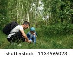 a man with a backpack  a father ... | Shutterstock . vector #1134966023