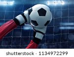 soccer goalkeeper catches the...   Shutterstock . vector #1134972299