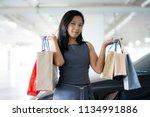 asian women are happy shopping...   Shutterstock . vector #1134991886