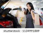 asian women keep shopping bags...   Shutterstock . vector #1134991889