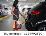 asian women keep shopping bags...   Shutterstock . vector #1134992510