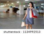asian women are happy shopping...   Shutterstock . vector #1134992513