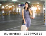 asian women are happy shopping...   Shutterstock . vector #1134992516