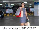 asian women are happy shopping...   Shutterstock . vector #1134992519