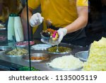 a man making kumpir at shop | Shutterstock . vector #1135005119