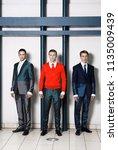 the three businessmen on... | Shutterstock . vector #1135009439
