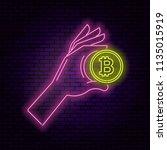 neon illustration the hand... | Shutterstock .eps vector #1135015919