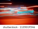 traces of headlights glow  ... | Shutterstock . vector #1135019546