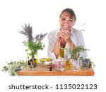 woman and essential oils in... | Shutterstock . vector #1135022123