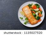 plate of baked salmon steak... | Shutterstock . vector #1135027520
