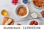 homemade granola in a plate ... | Shutterstock . vector #1135032146