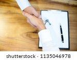 business man handshake for... | Shutterstock . vector #1135046978
