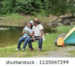 senior couple enjoying camping... | Shutterstock . vector #1135047299