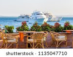 open air cafe tables with sea... | Shutterstock . vector #1135047710