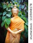 wat koh kaew in ayutthaya ... | Shutterstock . vector #1135048178