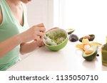 woman making nourishing mask... | Shutterstock . vector #1135050710