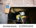 blurry rope access miner... | Shutterstock . vector #1135051043