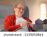 Senior Woman Knitting Warm...