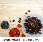 blue plate fresh overripe... | Shutterstock . vector #1135063490