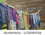 Stock photo washing line with drying clothes in outdoor clothes hanging on washing line in outdoor 1135083536
