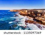 bright sandstone cliffs of cape ...   Shutterstock . vector #1135097369