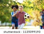 cute little children playing... | Shutterstock . vector #1135099193